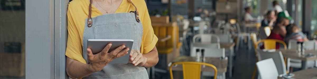 restaurant owner on tablet